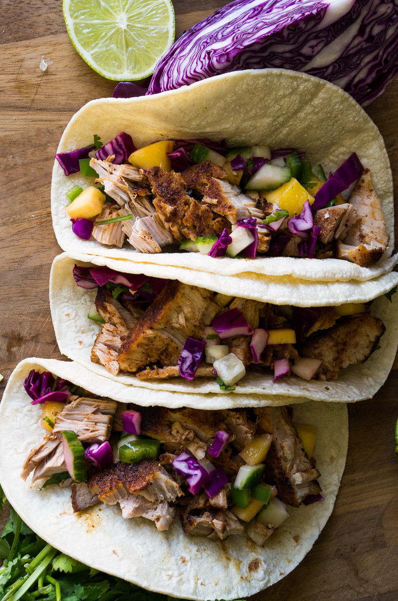 Valentine's Day Blackened Tuna Tacos with Mango Salsa-perfect date nights should include tacos. Wild caught tuna steaks are seasoned, seared, and in a corn tortilla topped with fresh mango salsa with jalapenos for some heat.| thekitcheneer.com