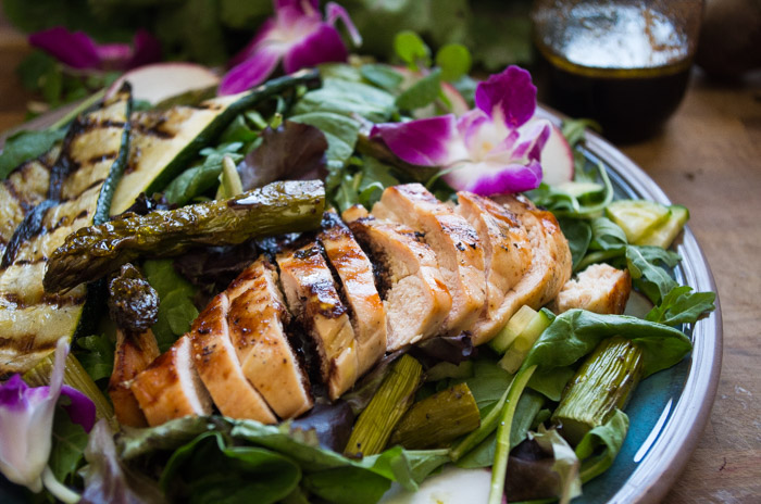 Spring Chicken Roasted Asparagus Salad- the perfect spring Whole30 recipe with a Beet Orange Basil Vinaigrette dressing that actually will make you CRAVE salad. Spring time vegetables are tossed with a Whole30 dressing and topped with grilled chicken.